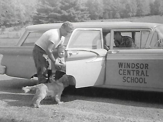 John Stanchak puts his son, Sonny, on what was then a Windsor School bus in the late 1950s/early 1960s.