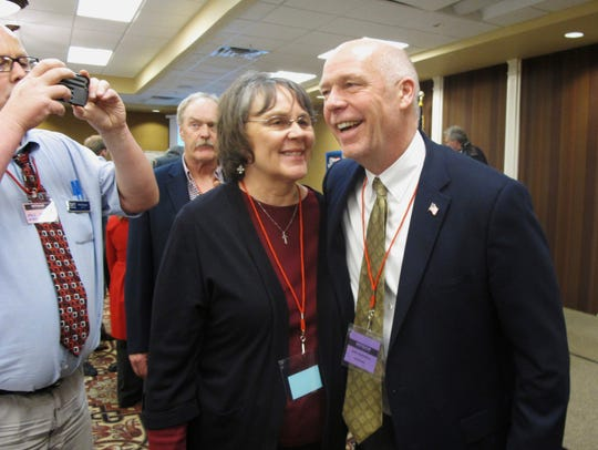 Greg Gianforte receives congratulations from a supporter