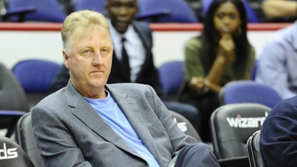 Pictured here in Washington during the 2014 playoffs, Larry Bird plans to be on the road more during the upcoming season.