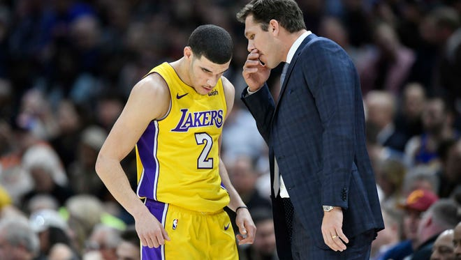 Los Angeles Lakers head coach Luke Walton talks to guard Lonzo Ball (2) in the first quarter against the Cleveland Cavaliers at Quicken Loans Arena.