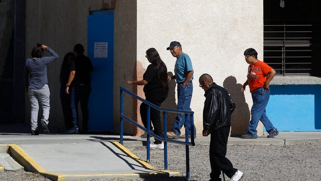 Voters enter the Shiprock Chapter house to vote on a a proposed $216 million transportation stimulus plan on Tuesday in Shiprock.