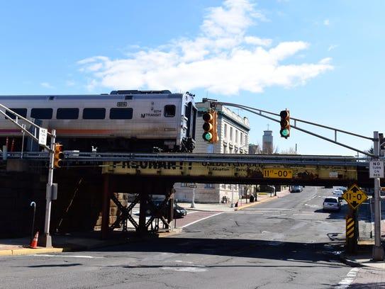 An NJ Transit passenger train passes over the train