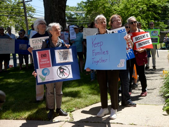 A group of concerned citizens gathered outside of Rutherford Congregational Church to participate in a national day of rallies and protests organized by activists behind Families Belong Together on Thursday, June 14th, 2018. The group is protesting the Trump administration's policy of separating parents and their children crossing the border.