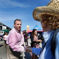 New Jersey Gov. Chris Christie shakes hands during a campaign stop with NASCAR fans at New Hampshire Motor Speedway before Sunday's Sprint Cup series auto race, Saturday, Sept. 26, 2015, in Loudon, N.H.  Christie is back in Loudon this evening for a town hall meeting. (AP Photo/Jim Cole)