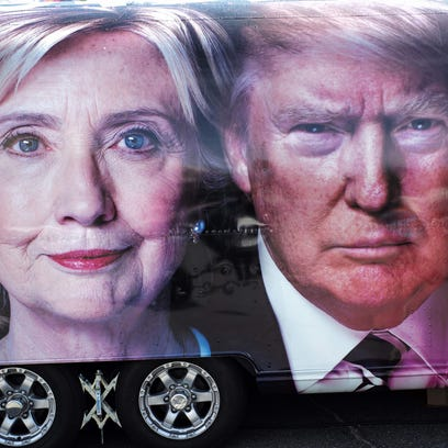 A TV van with pictures of both candidates is seen outside