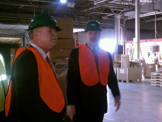 YDR Editor Jim McClure, left, talks to then-Wolf CEO Tom Wolf, now governor, in the company's West Market Street warehouse, in this photo from 2012.