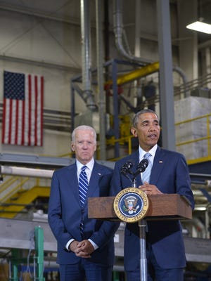 President Obama speaks next to Vice President Joe Biden following a tour of Techmer PM in Clinton, Tennessee on January 9, 2015. Techmer produces color and additive solutions for the plastics and fiber industries.