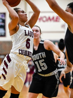 Henderson's Jaylee Carter (5) drives to the basket against South Warren's Jordan Mcdonald (40) as the Henderson County Lady Colonels play the South Warren Spartans at Henderson's Colonel Gym Friday, February 9, 2018.