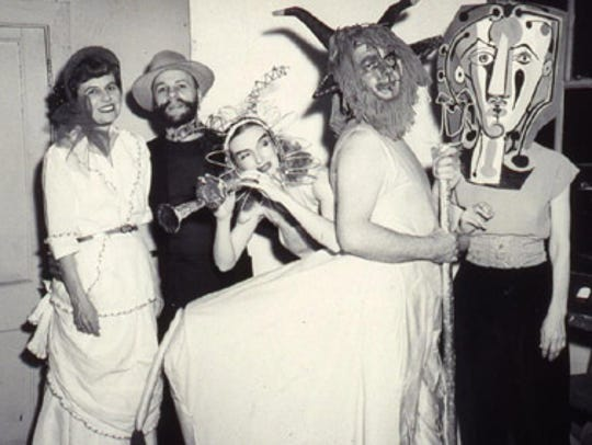 Revelers at a Memphis Academy of Arts masquerade ball.