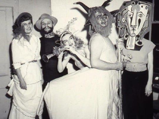 Revelers at a Memphis Academy of Arts masquerade ball.