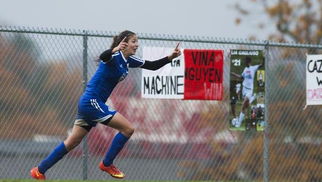 Colchester's Greetje Scheller (5) celebrates her overtime goal during a high school girls soccer game against Champlain Valley.