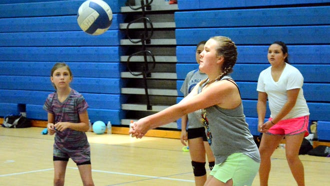 Grace Johnson, 12, works on her defense Tuesday at the Cavegirls volleyball camp for grades 6-9.