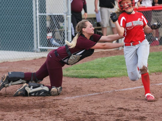 Oak Harbor's Seree Petersen avoids the tag of Willard's