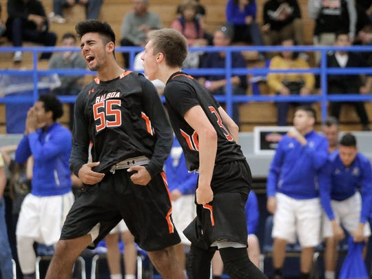 Balboa City players Jose Serrano, left, and Keenan Dowell celebrate after Dowell hit the game-winning 3-pointer to beat Eastwood in the McDonald's Classic Basketball Tournament on Friday at Eastwood High School.