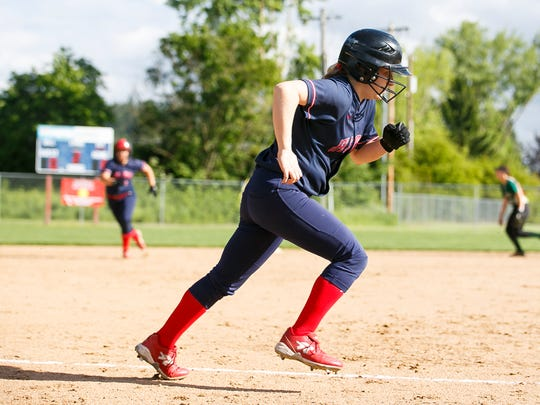 Kennedy's  Rebecca Pranger runs for home plate in a first round playoff game against Gaston on Wednesday, May 24, 2017, at Kennedy High School in Mt. Angel, Ore. Kennedy defeated Gaston 15-2 after five innings.