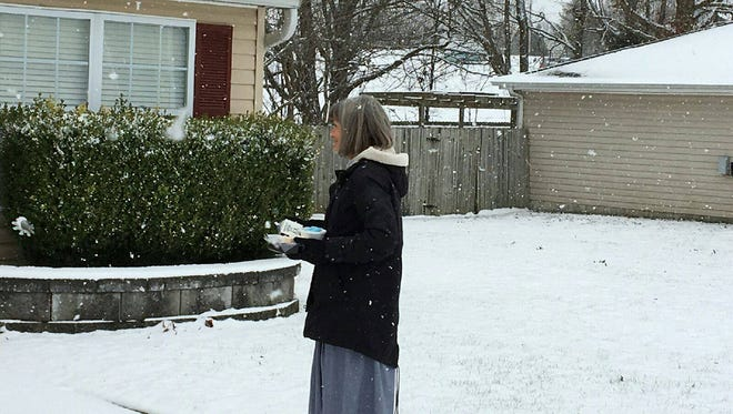 Becky Griffin, of Fairview, delivers Meals On Wheels today despite the inclement weather.
