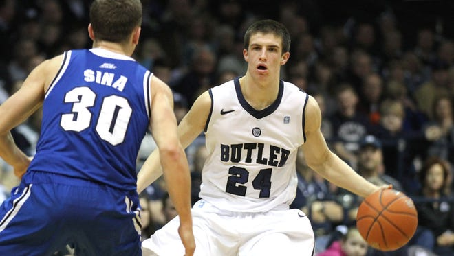Butler's Kellen Dunham brings the ball up the court against Seton Hall's Jaren Sina during the first half of the game Saturday March 8, 2014 at Hinkle Fieldhouse.