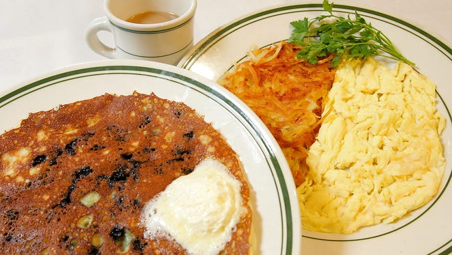 Hash browns, scrambled eggs and blueberry pancakes are served at the Sunshine Cafe in Cathedral City.
