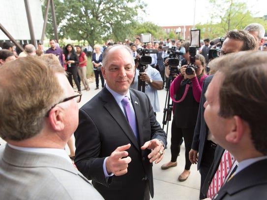 Governor John Bel Edwards speaks to local dignitaries