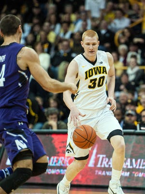Iowa forward Aaron White (30) dribbles against Northwestern during the first half at Carver-Hawkeye Arena. White scored 25 points in the Hawkeyes' 69-52 senior day victory.