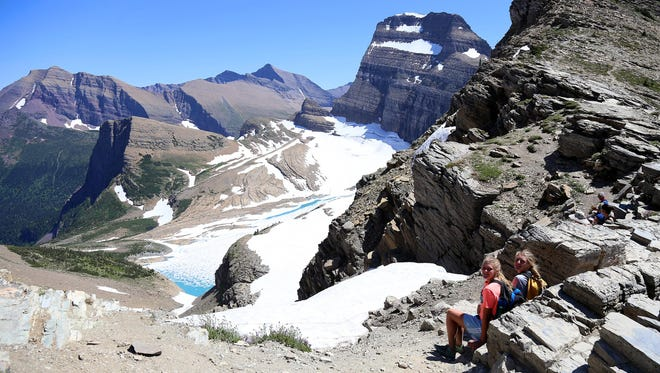 Hallie Thompson, left, and Lizzie Thompson hang out at the top of Grinnell Glacier Overlook of the Highline Trail.