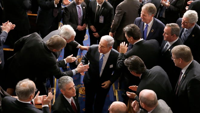 Israeli Prime Minister Benjamin Netanyahu shakes hands as he leaves the House chamber Tuesday on Capitol Hill in Washington, D.C., after addressing a joint meeting of Congress.
