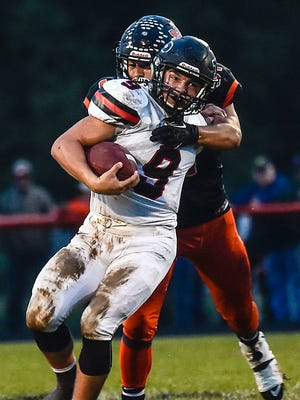 Pleasant junior Matt Chase gets tackled from behind at North Union last week. The Spartans host Buckeye Valley in a Mid Ohio Athletic Conference Red Division matchup Friday at 7 a.m.