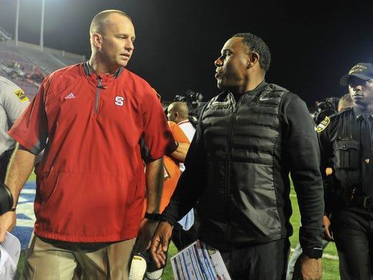 Vanderbilt coach Derek Mason, right,  and North Carolina