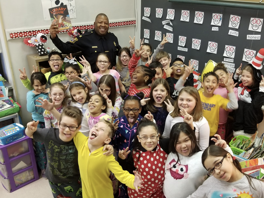 "Capt. Abdul Williams of the Linden Police Department read ""Library Mouse"" to third-graders at School No. 6 on Friday, March 2."