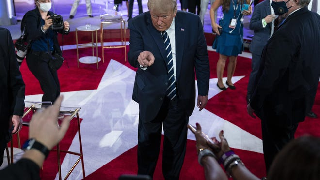 President Donald Trump talks with voters after an NBC News Town Hall, at Perez Art Museum Miami, Thursday, Oct. 15, 2020, in Miami.