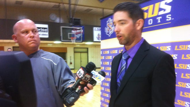 New LSUS athletic director Lucas Morgan visits with the media Tuesday while Mark Cantrell looks on.