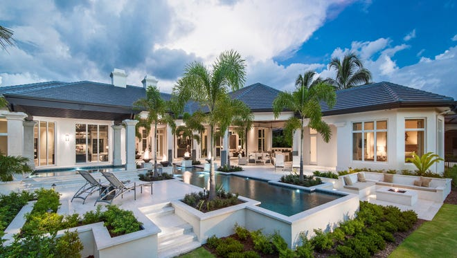 Cascading pool and outdoor living space in Harwick Homes new estate home in Grey Oaks.