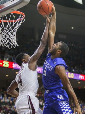 Texas A&M Aggies forward Tavario Miller (4) attempts to block a shot by Kentucky Wildcats guard Aaron Harrison (2) during the first half at Reed Arena. The Wildcats defeated the Aggies 70-64 in double overtime.