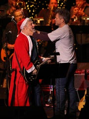 Jon Bon Jovi performs with Bobby Bandiera during the