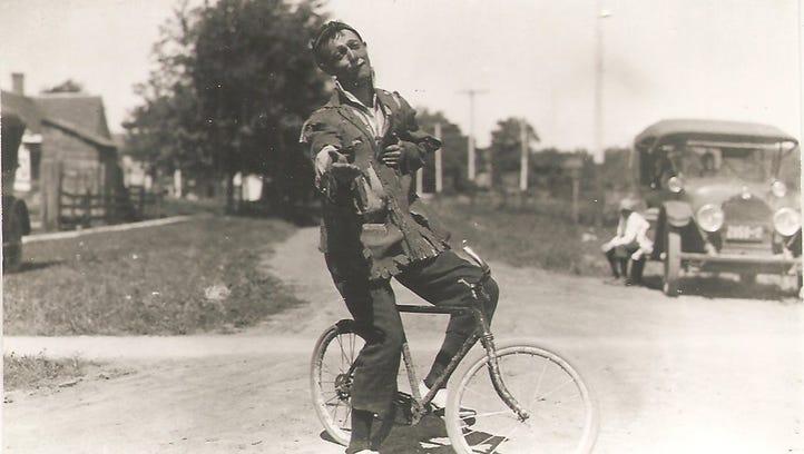 A 1920's era photo captures Joe Coyle, a clown with