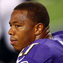 Ray Rice #27 of the Baltimore Ravens sits on the bench against the Dallas Cowboys in the first half of their preseason game at AT&T Stadium on August 16, 2014 in Arlington, Texas.