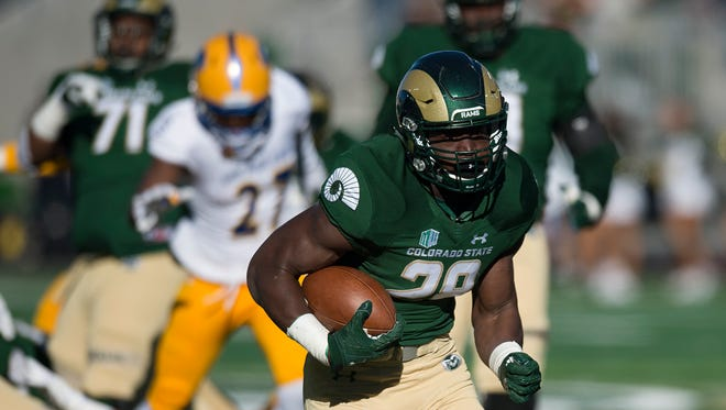 """Running back Rashaad Boddie, shown running away from San Jose State defenders during a Nov. 18, 2017, home game, has been """"suspended from practice,"""" CSU football coach Mike Bobo said Tuesday, declining to elaborate."""
