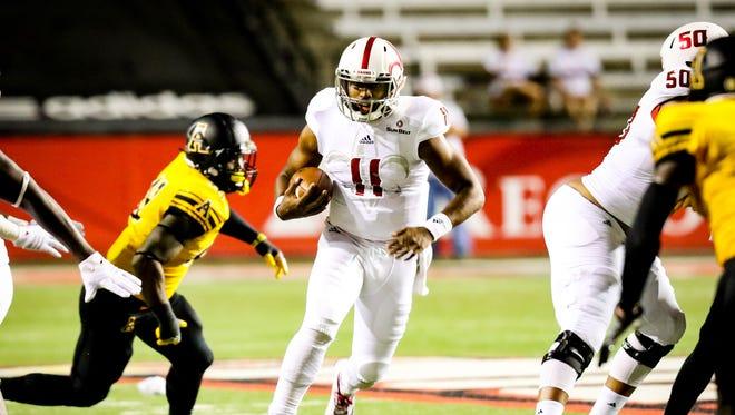UL quarterback Anthony Jennings runs for a few yards against Appalachian State.