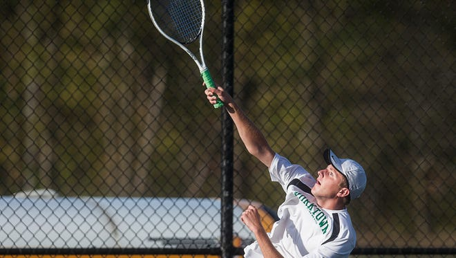 Yorktown's Jason Maynard and Johnny Jameson face off against Burris during the boys tennis sectional at Delta High School on Wednesday, Sept. 30, 2015.