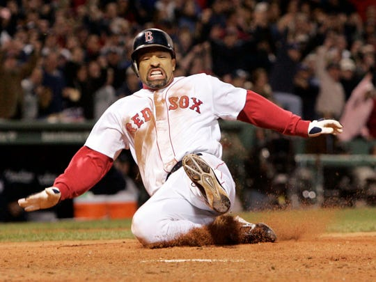 Boston Red Sox's Dave Roberts slides home to score the tying run against New York Yankees' Mariano Rivera in the ninth inning of game 4 of the ALCS Sunday, Oct. 17, 2004 in Boston. (AP Photo/Elise Amendola) ORG XMIT: BXF142