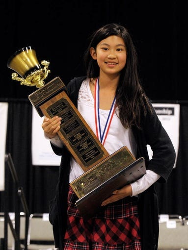 Mission Valley Elementary's Eileen Xue, pictured, of Tulare, wins the 2014 Tulare County Spelling Championship Wednesday at the Visalia Convention Center. Eileen out spelled 238 other fourth through eighth graders from schools in Tulare County.