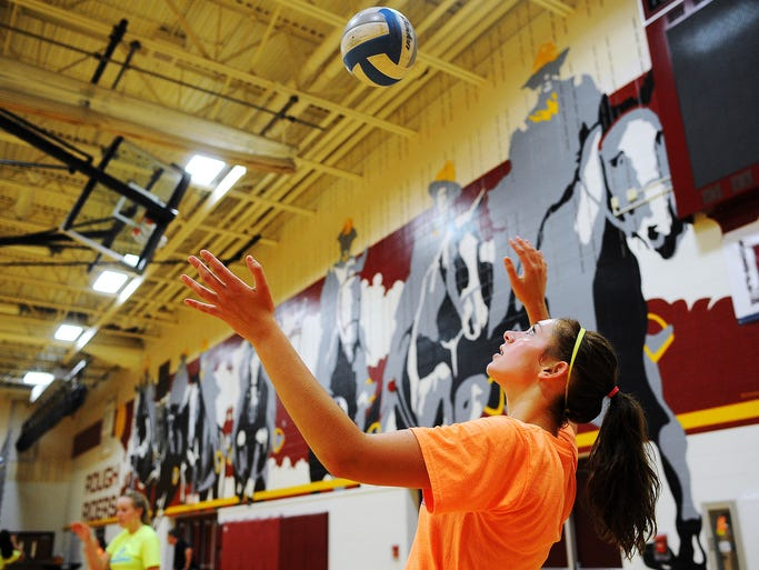 Roosevelt's Tagyn Larson serves the ball while participating in a drill during a volleyball practice on Thursday, Aug. 28, 2014, at Roosevelt High School in Sioux Falls, S.D.