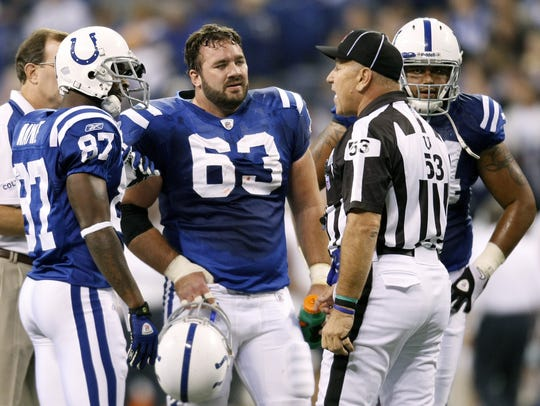 Jeff Saturday talks with an official during a time