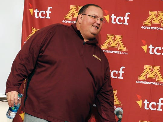 Tracy Claeys, named interim football coach/defensive coordinator at the University of Minnesota following the retirement announcement by coach Jerry Kill, arrives to address members of the media, Wednesday, Oct. 28, 2015, in Minneapolis.