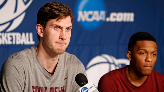 Arizona State center Jordan Bachynski (left) and guard Jahii Carson (right) during a press conference before the second round of the 2014 NCAA Tournament at BMO Harris Bradley Center.