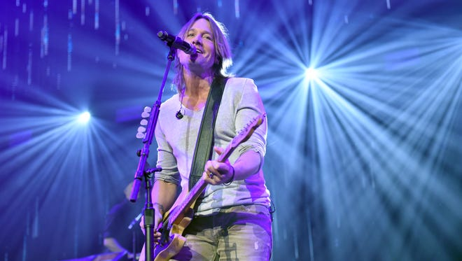 Keith Urban performs onstage for the Country Rising Benefit Concert at Bridgestone Arena on Nov. 12, 2017 in Nashville, Tenn.