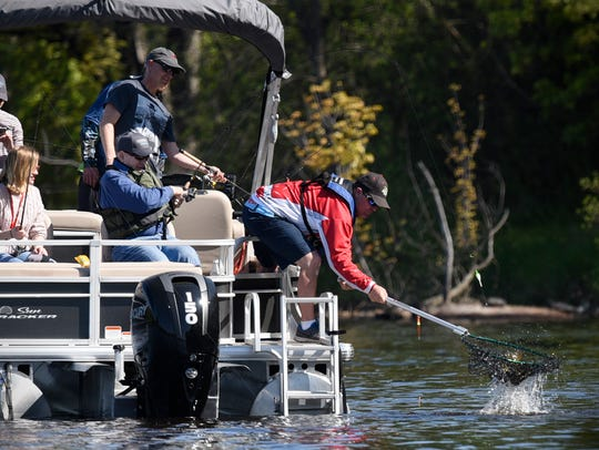 Gov. Mark Dayton catches a fish during the 2017 Governor's