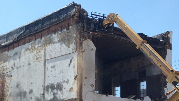 COFO building, where civil rights workers James Chaney, Mickey Schwerner and Rita Schwerner worked, is torn down April 21.