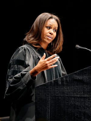 First lady Michelle Obama delivers the commencement address during graduation ceremonies for the Class of 2015 at Dr. Martin Luther King College Preparatory High School held on the campus of Chicago State University, Tuesday, June 9, 2015, in Chicago. King College Prep is the high school where Hadiya Pendleton would have graduated if she hadn't been shot and killed in a gang incident. (AP Photo/Charles Rex Arbogast)
