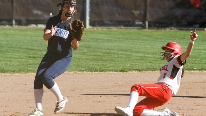 Foothill High's Riley Roach slides safely into third base while Pleasant Valley's Keeli Bryant waits for the throw during Tuesday's softball game at Hooker Oak Recreation Park in Chico.